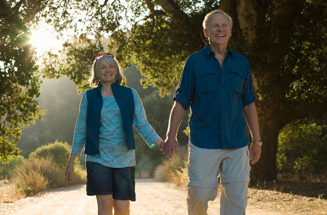 Active Mature White Couple Trail Walking